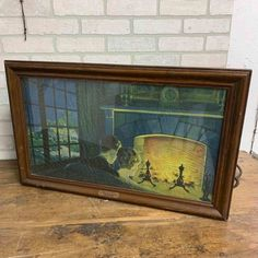 This vintage Scene-In-Action photograph depicts a couple watching the fireplace with a window to the side of them. The back portion has two light bulbs and spinners in it. The heat from the lights would make the spinners spin which would make the fire appear to flicker and light to come through the window. When … Vinta… Flea Market Finds, Antiques For Sale, Through The Window, Fireplace Mantels, Wooden Frames, Bulbs, Spin, Primitive, Light Bulb