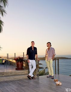 Interior designers Randy Kemper (left) and Tony Ingrao on a terrace at their vacation compound on St. John, U.S. Virgin Islands, with their miniature dachshund, Oola | archdigest.com