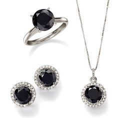 Black diamond necklace and stud earrings with a halo of dazzling white diamonds. Classic black diamond solitaire ring looks elegant. >>Click on the black diamonds for more  jewelry styles.