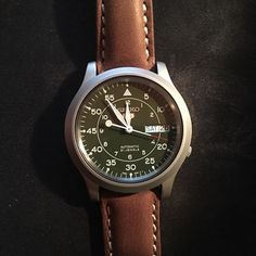 SNK805 with brown strap