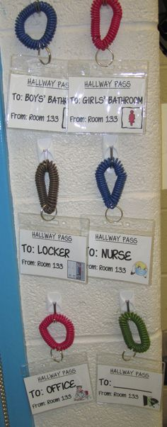 Hall Pass - Print on card stock and put into ID badge holders on coil key chains (both from Walmart). Blank pass at end can be written on with a whiteboard marker and then erased (for students who have to go somewhere else in the building). These are waterproof (seal the top opening with packing tape or buy self-seal ID badge holders) and kids wear them high up on their arms so they don't get wet/dirty in the bathroom.