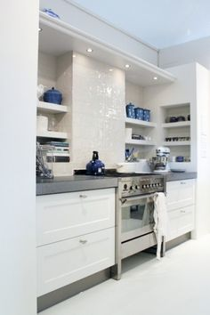 Got this kind of kitchen - modern meets rustic. Mine is from Siematic. Got the stoof - briljant! Worth every cent.