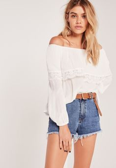 We are crazy for crotchet this season, so channel your inner boho babe and grab this crotchet detail top.  Warmer climes means the shoulders come out, so make sure they are good to go and dress them in this little beaut. In a bardot style w...