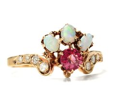 Diamond, opals, and garnet in 14K yellow gold; center gem c.1910; shank with diamonds later 20th century
