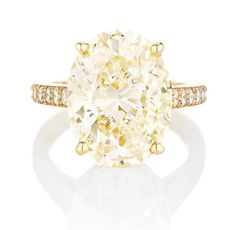 The Old Bond Street yellow gold ring, from De Beers, showcases a yellow oval-cut diamond and pavé diamonds. Sapphire Diamond Engagement, Solitaire Engagement, Wedding Rings Vintage, Wedding Jewelry, The Bling Ring, Do It Yourself Fashion, Jewelry Stores Near Me, Titanium Wedding Rings, Gemstone Rings
