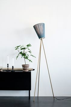 Set the mood for style with Oslo Wood, a trendy floor lamp with a tripod base and multi-directional shade. The shade rotates around a gimbal fastened to the top of the tripod, giving it the potential to angle light in. Oslo, Herringbone Wooden Floors, Seagrass Wallpaper, Wood Floor Lamp, Floor Lamps, Dark Furniture, The Way Home, Gold Wood, Hu Ge