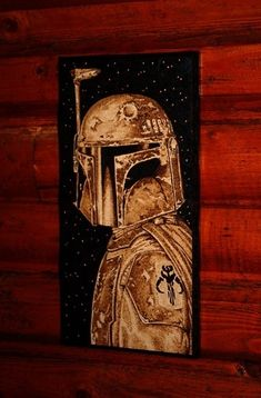 """Get a wood burned Boba Fett all up on your wall. 