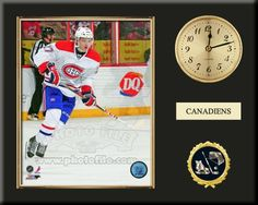 One 8 x 10 inch Montreal Canadiens photo of Alex Galchenyuk inserted in a gold slide-in frame and mounted on a 12 x 15 inch solid black finish plaque.  Also features a 3-inch Arabian gold-faced clock, a customizable nameplate* and a 2-inch hockey medallion with a gold base. $59.99  @ ArtandMore.com