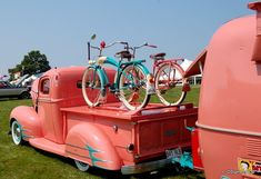 Bubble gum pink vintage truck, camper trailer and bicycles