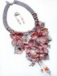 Pink and Silver Beads and Lots of Talent create a Fabulous Necklace.
