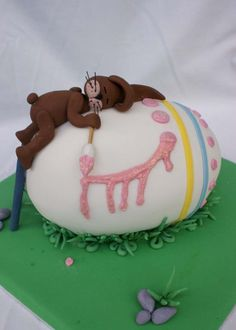 Easter Bunny sleeping on an Easter Egg Cake