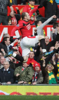 @manutd's no.10 Wayne Rooney leaps for joy after converting a penalty against Liverpool at Old Trafford.
