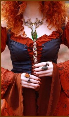Beautiful. Red orange blue color scheme dress with elvish wand and crystal necklace