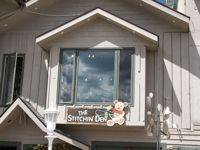 The Stitchin Den, Estes Park CO (cross stitch and needlepoint downstairs; yarn — and two cute terriers — upstairs!)