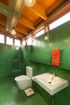 Vibrant green tile adds punch to the bathroom.