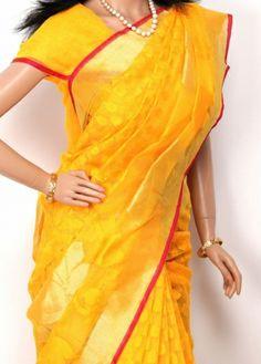 Yellow with Golden Jari Border Thread Embroider Fancy Net Silk Saree. http://www.shreedevitextile.com/women/sarees/fancy-saree/shree-devi/yellow-with-golden-colored-net-silk-saree