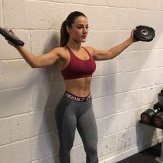Shoulder workout at gym woman intimidating