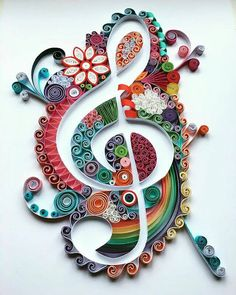 A wonderfully quilled, decorated treble clef sign - by: Carla Bagshaw