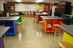 Name: Tara Conover School: Lynnville-Sully Schools Town: Sully  State: Iowa  I built tables this year and put them on casters so I can have the flexiblity of 1 large table, 3 long tables, or 6 square tables.  The great thing is that I have storage under all of them for sketchbooks and supplies.  I use them as a color teaching tool and have them set up with warm colors on one side and cool colors on the other.  They are also placed across from their complement.  The stools were also labeled…