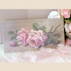 All of Christie Repasy's original canvas prints are hand-stretched onto a wooden frame. Each lithograph is treated with a clear coating to create the look and feel of an original painting! Her use of soft colors, lush roses and adorable animals make her paintings perfect for any Shabby Cottage style home! Christie signs and dates each print for authenticity. The prints can be framed or hung on the wall as is! A gorgeous addition to any collection.  6h x 12w x d