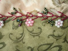 https://flic.kr/p/6bTTL3 | Crazy Patch Seam Treatment - Feather stitch with beaded flowers