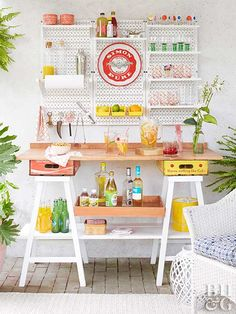 Raise the bar for your outdoor living space with a DIY beverage center. Stocked with glassware, cocktail tools, fresh fruit, and more, this patio bar will have you sipping in style all summer long.