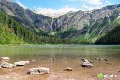 After a 2-hour hike among the peaks and valleys of Montana's Glacier National Park, lucky travelers will arrive at Avalanche Lake, an unbelievably clear lake nestled among snowy mountains and cascading waterfalls. Can you imagine a better place for a mid-summer swim? (Photo by Lora Kapp)