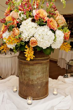 Utilize a vintage milk jug to hold your flowers.