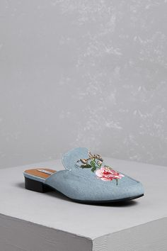A pair of canvas loafer mules featuring ornate floral embroidery, an almond toe, high-polish bit buckle detail, slight heel, and an open back.<p>- This is an independent brand and not a Forever 21 branded item.</p>