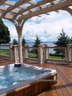 A stunning deck with pergola and glass rails on Lake Ontario