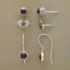 """Three different settings make garnet the center of attention. Handcrafted Sundance exclusive in sterling silver. Set of 3. 5/16"""" to 7/8""""L."""