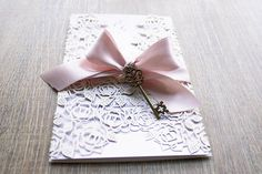 laser cut wedding invitation, wedding invitation with ribbon