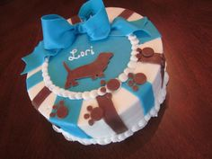 Made this cake for a dog lover, especially her basset hound, bc frosting with fondant accents