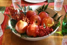 Here's a simple Fall table centerpiece you can put together in less than 5 minutes. Fill a large bowl of apples with seasonal red nandina berries! Enjoy!