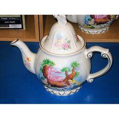 Disney Alice in Wonderland Tea Pot by Disney Theme Park Merchandise, http://www.amazon.com/dp/B001T7HSYO/ref=cm_sw_r_pi_dp_g16Epb00MGWF3