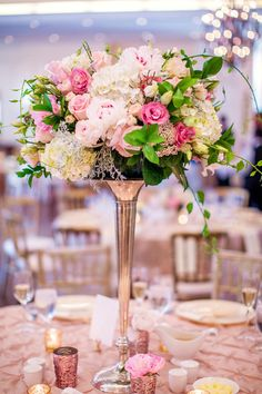 Towering silver trumpet vases filled with peonies, roses, hydrangeas, rice flower, and greenery! {@theamymarie}