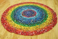 It's toy cars arranged in a rainbow. So, too much fun to leave, I guess...