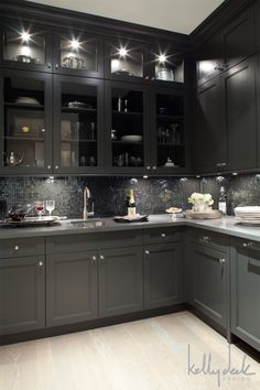 dark cabinetry, light floors