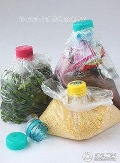Cut off the top of plastic bottles, feed the plastic bag through the funnel and screw on the lid!