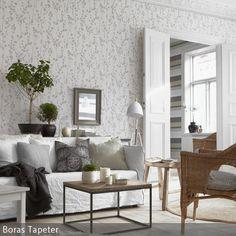 Tapeten mit verschiedenen Motiven geben der Wohnung eine individuelle Note und erzeugen eine lockere Atmosphäre. Das florale Muster in Grau-Weiß unterstützt …