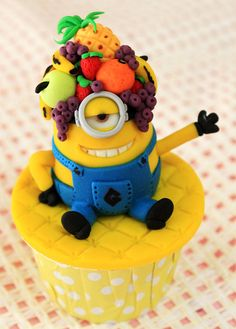 Minion Cupcake~ here a great cupcake. I love it & I'm sure that the kiddos would also! Tell U what, come for a visit & I'll mske one for them both! Ok? Lol!... love you