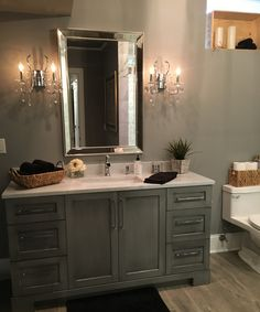 Bathroom. Grey bathroom cabinet. Custom cabinets are from A.W.E (Artistic Wood…