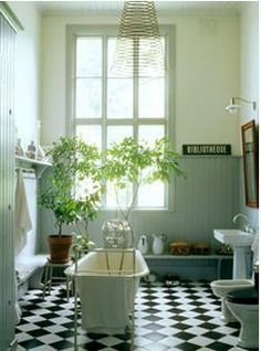 Black-white and tongue and groove -- Gunnel Sahlin's bathroom in Sweden -- It's just missing a shower, otherwise, perfect! Bathroom Plants, Bathroom Wall Decor, Bathroom Styling, White Bathroom, Modern Bathroom, Small Bathroom, Bathroom Interior, Checkerboard Floor, Black And White Tiles