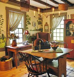 primitive country dining room, hutch, corner wing chair, candle chandelier, tied-back panels; no murals though Primitive Homes, Primitive Dining Rooms, Primitive Kitchen, Country Primitive, Country Kitchen, Country Farmhouse, Country Homes, Primitive Bedroom, Vintage Farmhouse
