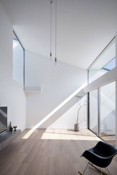 clean minimal bright interior. tall space with high windows to bring light in and feature pendant lighting