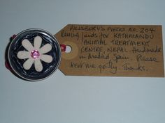 Pillsbury's Pieces No, 204. Pin with black capsule with pale pink flower. In exchange for a donation to KATHMANDU ANIMAL TREATMENT CENTRE, Nepal. Available at St. George's Church, Madrid on Saturday 13 June from 11.00 - 15.00.