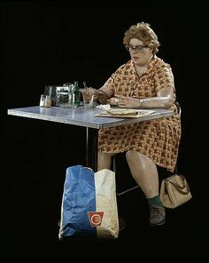 Duane Hanson, Woman eating 1971, Sculpture: polyester resin, fiberglass, polychromed in oil paint with clothes, table, chair and accessories (life sized)