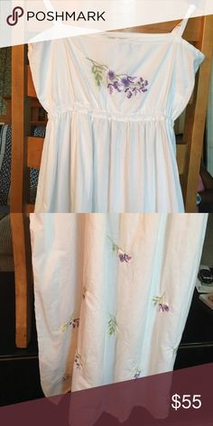 White summer dress This elegant white summer dress with it detail embroidery of purple and white flowers .great for a summer party. Size small Dresses Maxi