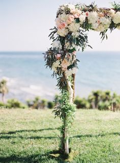 Hydrangeas, peonies, and garland for days: http://www.stylemepretty.com/2015/01/09/pastel-spring-wedding-at-dos-pueblos-ranch/   Photography: Pat Moyer - http://patmoyerweddings.com/