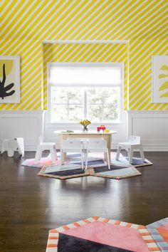 colorful kids' playroom with yellow striped wallpaper